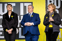 "© Licensed to London News Pictures. 23/03/2019. London, UK. Caroline Lucas (L), Ian Blackford (C) and Anna Soubry (R) on stage in Parliament Square after an estimated one million people marched through central London to demand that government allow a ""People's Vote"" on the Brexit deal. Several key votes will be held in Parliament in the coming week. Photo credit: Rob Pinney/LNP"