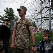 5/5/11 -- TOPSHAM, Maine. LCPL Parise holds his son Eli's hand prior to departure on Thursday morning. U.S. Marine Reservists departed from Topsham on Thursday for the start of a year-long deployment to Afghanistan amidst a crowd of family, friends and well-wishers. This mission will be different from others, said several Marines, because instead of doing combat operations they will be teaching the Afghan National Army to operate independently. They travel first to California for several months of training and are planning to return in May 2012. Photo by Roger S. Duncan.