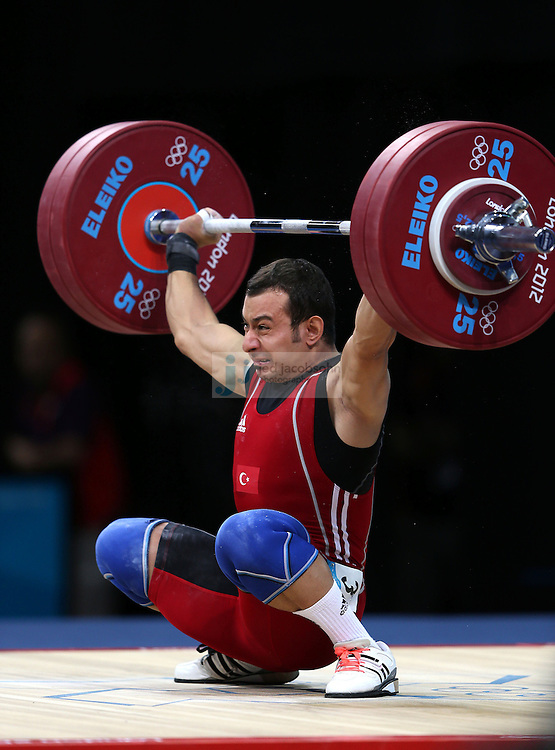 Bilgin Erol of Turkey  attempts to lift 140 kg during the mens 62kg weightlifting event during day 3 of the London Olympic Games London, 30 Jul 2012..(Jed Jacobsohn/for The New York Times)....
