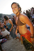A cute hippy girl smiling, dancing, Sunset beach party, Benirras Beach, Ibiza, July 2006