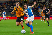 Robbie McKenzie of Hull City holds off Stewart Downing of Blackburn Rovers during the EFL Sky Bet Championship match between Hull City and Blackburn Rovers at the KCOM Stadium, Kingston upon Hull, England on 20 August 2019.
