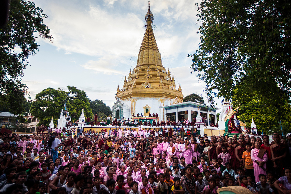Crowds gather to watch a performance at a temple in Myanmar.