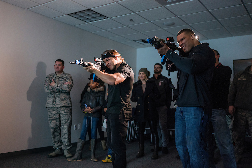 Prince George's County, MD - December  13, 2016:  WWE Superstars Chad Gable, left, and Jason Jordan, right, of the tag team American Alpha, use weapons fitted with lasers to compete in a hostage simulation video during Tribute to the Troops Day at the Joint Base Andrews in Prince George's County, Maryland.  WWE Superstars will spend time with members of all five branches of the military.  WWE began Tribute to the Troops in 2003 as a way to honor our servicemen and women and their families.   (Greg Kahn for ESPN)