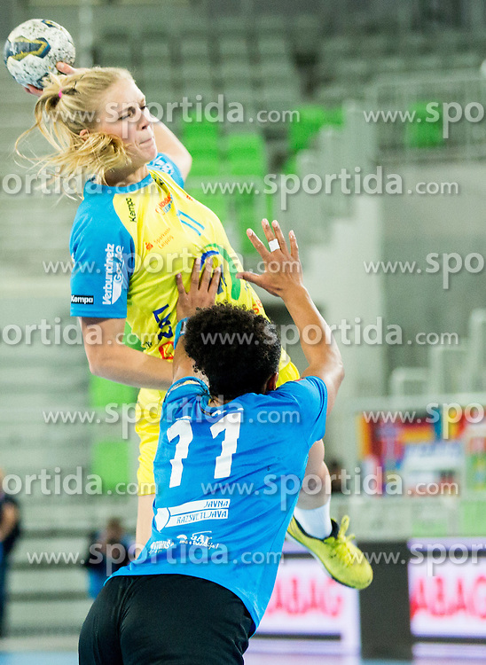 Anne Hubinger of Leipzig vs Amelie Goudjo #11 of Krim Mercator during handball match between RK Krim Mercator (SLO) and HC Leipzig (GER) in 6th Round of Women's EHF Champions League 2014/15, on November 21, 2014 in Arena Stozice, Ljubljana, Slovenia. Photo by Vid Ponikvar / Sportida