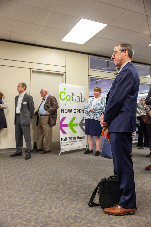 Brad Cohen, senior vice provost for instructional innovation, and other invited guests listen to Duane Nellis, Ohio University president, speak at the grand opening and ribbon cutting for the new CoLab, October 18, 2018. (Photo by Stephen Zenner/Ohio University Libraries)