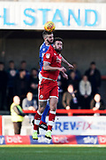 Fiacre Kelleher of Macclesfield Town heads the ball over Ollie Palmer of Crawley Town during the EFL Sky Bet League 2 match between Crawley Town and Macclesfield Town at The People's Pension Stadium, Crawley, England on 23 February 2019.