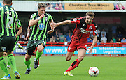 Gwion Edwards being chased by Dannie Bulman during the Sky Bet League 2 match between Crawley Town and AFC Wimbledon at the Checkatrade.com Stadium, Crawley, England on 15 August 2015. Photo by Michael Hulf.