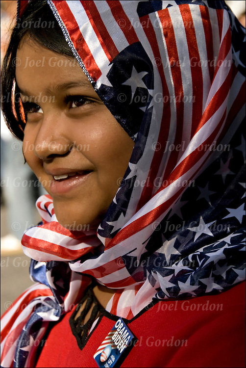 Portrait of Aliza a ten year old first generation Pakistani American Muslim girl wearing American flag headscarf and a Obama / Biden pin at the American Muslim Day Parade in New York City.<br />