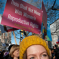 London UK. January 21st 2017.An estimated 100,000 protesters took part in a Women's March from the US Embassy in Grosvenor Square to Trafalgar Square as part of an international campaign on the first full day of Donald Trump's Presidency of the United States. Placard saying 'Thou shalt not mess with women's reproductive rights'.