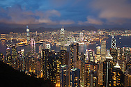 View of the Central (foreground) and Kowloon districts of Hong Kong at dusk.  The view is from Victoria Peak. http://www.gettyimages.com/detail/photo/hong-kong-at-dusk-viewed-from-victoria-peak-royalty-free-image/121357423