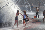 People playing in the International Fountain, Seattle, Washington, USA