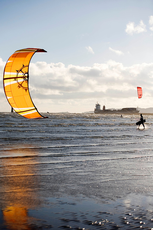 Ireland, Dublin. Kite surfing at the mouth of Dublin's port