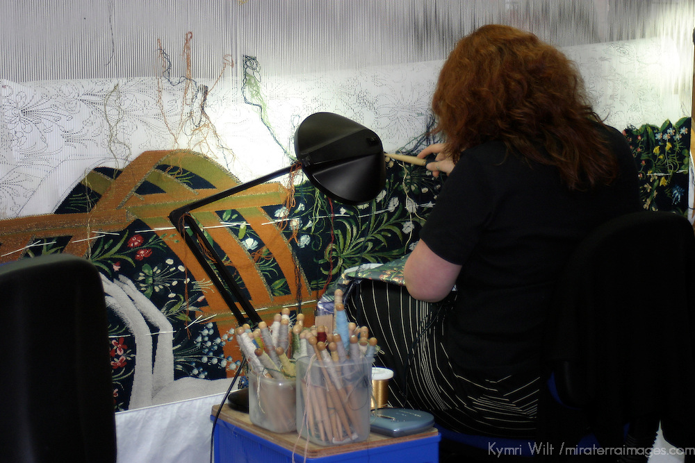 Europe, Great Britain, United Kingdom, Scotland. A tapestry weaver at work in Stirling Castle.