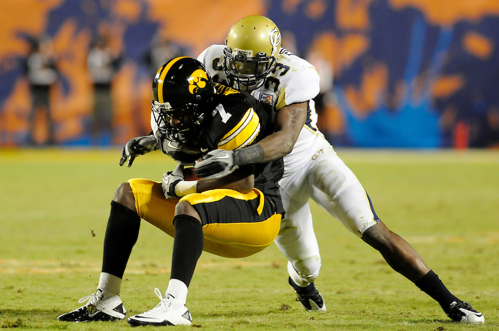 January 5, 2010: Tyler Jarry of the Georgia Tech Yellow Jackets tackles Marvin McNutt of the Iowa Hawkeyes during the NCAA football game between the Georgia Tech Yellow Jackets and the Iowa Hawkeyes in the FedEx Orange Bowl at LandShark Stadium in Miami Gardens, Florida. The Hawkeyes defeated the Yellow Jackets 24-14.