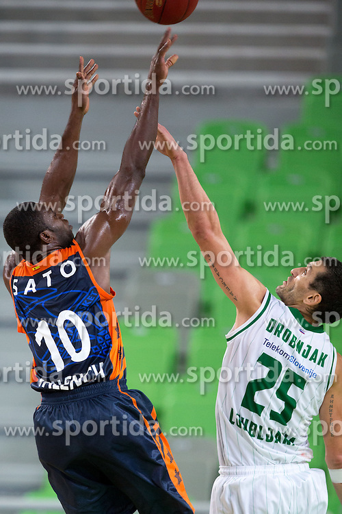 Romain Sato #10 of Valencia BC shoots against Dragisa Drobnjak #25 of KK Union Olimpija during basketball match between KK Union Olimpija and Valencia BC (SPA) of 3rd Round of Regular season of EuroCup 2013/2014 on October 30, 2013, in SRC Stozice, Ljubljana, Slovenia. (Photo by Matic Klansek Velej / Sportida)