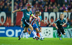 MADRID, SPAIN - Wednesday, October 22, 2008: Liverpool's captain Steven Gerrard MBE and Club Atletico de Madrid's Ignacio Camacho during the UEFA Champions League Group D match at the Vicente Calderon. (Photo by David Rawcliffe/Propaganda)