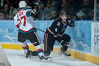 KELOWNA, CANADA -FEBRUARY 5: Ryan Olsen #27 of the Kelowna Rockets checks Haydn Fleury D #4 of the Red Deer Rebels into the boards on February 5, 2014 at Prospera Place in Kelowna, British Columbia, Canada.   (Photo by Marissa Baecker/Getty Images)  *** Local Caption *** Ryan Olsen; Haydn Fleury;