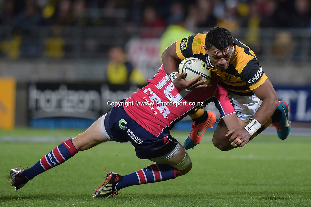 Taranaki's Seta Tamanivalu (R is tackled by Tasman Makos Marty Banks during the ITM Cup Premiership Final between Taranaki & Tasman at Yarrow Stadium in New Plymouth, New Zealand, 25th October 2014. Photo: Marty Melville/Photosport.co.nz