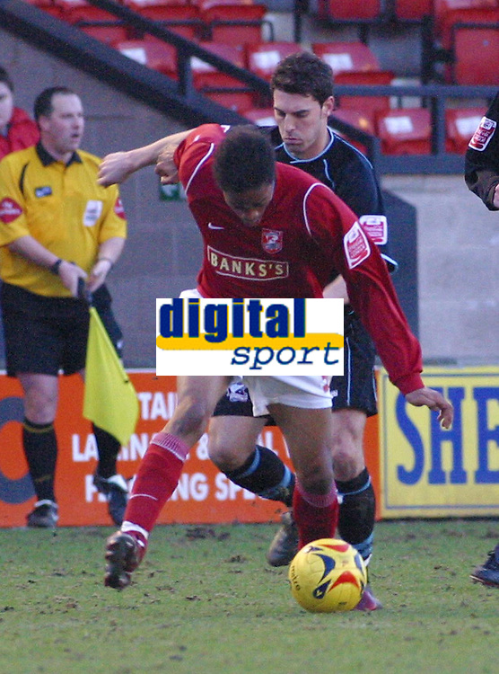 Photo: Dave Linney.<br />Walsall v Scunthorpe United. Coca Cola League 1. 11/02/2006Walsall' .Ishmel Demontagnac (L)leaves  Matthew Sparrow in his tracks