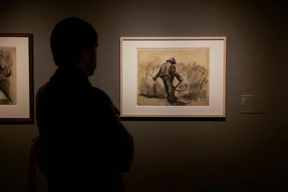 A man enjoys Van Gogh's drawing tittled 'Reaper' at the 'Van Gogh in the Borinage' exhibition at Le Mus&eacute;e des Beaux-arts in Mons. <br /> Mons is a Belgian city and municipality, and the capital of the province of Hainaut. Together with the Czech city of Plzeň, Mons is the European Capital of Culture in 2015.