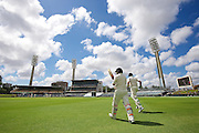 Tom Latham of the New Zealand Black Caps and Martin Guptill of the New Zealand Black Caps make their to the middle during Day 5 on the 17th of November 2015. The New Zealand Black Caps tour of Australia, 2nd test at the WACA ground in Perth, 13 - 17th of November 2015.   Photo: Daniel Carson / www.photosport.nz