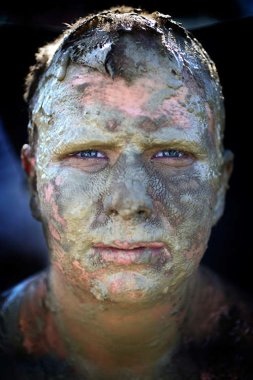 John Ingram is caked in mud after racing a friend through the muck at the monster truck course before a race a the Redneck Yacht Club in Punta Gorda, Fla. Photo by: Greg Kahn