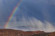 Rainbow and rain storm over mesas on the east side of the Pajarito Plateau, Jemez Mountains, NM, © 2011 David A. Ponton
