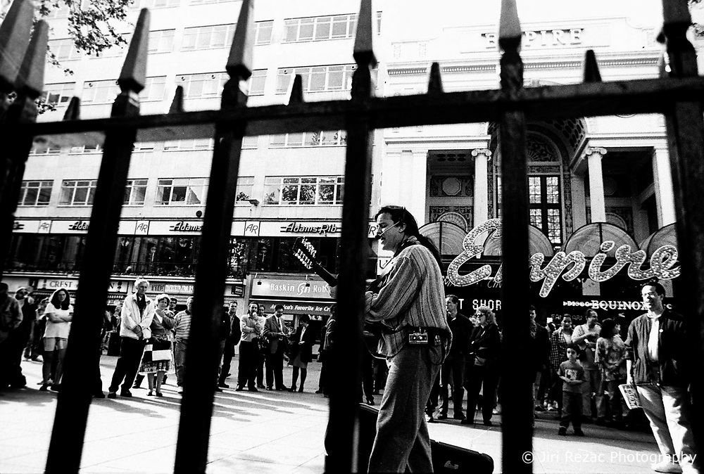 BRITAIN LONDON JUN97 - Irish street musician Brian Bruno performs in Leicester Square in front of the Empire cinema. ..jre/Photo by Jiri Rezac..© Jiri Rezac 1997..Contact: +44 (0) 7050 110 417.Mobile:  +44 (0) 7801 337 683.Office:  +44 (0) 20 8968 9635..Email:   jiri@jirirezac.com.Web:     www.jirirezac.com..© All images Jiri Rezac 1997 - All rights reserved.