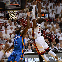 Jun 17, 2012; Miam, FL, USA; Miami Heat shooting guard Dwyane Wade (3) shoots against Oklahoma City Thunder guard James Harden (13) during the second half in game three in the 2012 NBA Finals at the American Airlines Arena. Miami won 91-85. Mandatory Credit: Derick E. Hingle-US PRESSWIRE