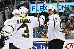 March 5, 2011; San Jose, CA, USA;  Dallas Stars left wing Jamie Benn (14) celebrates with defenseman Stephane Robidas (3) after scoring a short handed goal against the San Jose Sharks during the first period at HP Pavilion. Mandatory Credit: Jason O. Watson / US PRESSWIRE