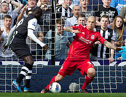 NEWCASTLE-UPON-TYNE, ENGLAND - Sunday, April 1, 2012: Newcastle United's Papiss Cisse scores the second goal against Liverpool and Martin Skrtel during the Premiership match at St James' Park. (Pic by Vegard Grott/Propaganda)