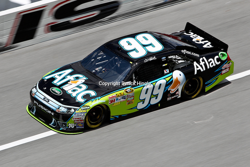 April 16, 2011; Talladega, AL, USA; NASCAR Sprint Cup Series driver Carl Edwards (99) during qualifying for the Aarons 499 at Talladega Superspeedway.   Mandatory Credit: Derick E. Hingle