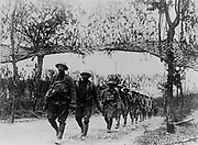 World War I 1914-1918: American Army infantry troops marching northwest of Verdun,  France, African-American unit.