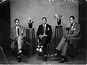 Three Nubian have their photo taken in a photo studio in downtown Nairobi.  (1940s)