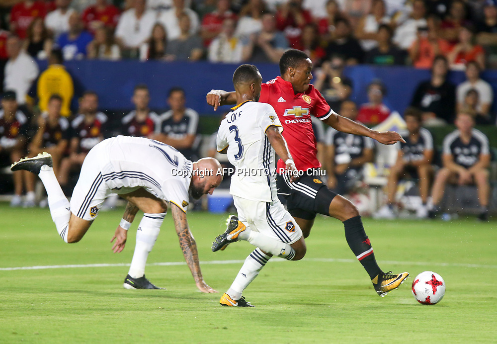 Manchester United Anthony Martial, right, kicks the ball against Los Angeles Galaxy during the second half of a national friendly soccer game at StubHub Center on July 15, 2017 in Carson, California. The Manchester United won 5-2. AFP PHOTO / Ringo Chiu