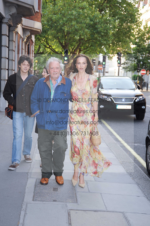 DAVID BAILEY and his wife CATHERINE at a private view of photographs by David Bailey entitled 'Then' held at Hamiltons, 13 Carlos Place, London W1 on 6th July 2010.