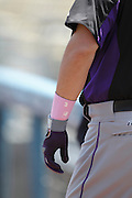 LOS ANGELES, CA - MAY 13:  Michael Cuddyer #3 of the Colorado Rockies wears a pink wrist band during batting practice during the game against the Los Angeles Dodgers on Sunday, May 13, 2012 at Dodger Stadium in Los Angeles, California. The Dodgers won the game 11-5. (Photo by Paul Spinelli/MLB Photos via Getty Images) *** Local Caption *** Michael Cuddyer