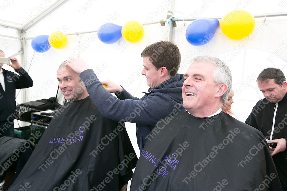 Superintendent John Kerin smiling before getting his head shaved as Clare Hurler Tony Kelly shaves Garda Frank Browne head at the Shaved at  the Garda Shave or Dye event in O'Connell Square Ennis. .<br /> Pictured Credit Brian Gavin Press 22