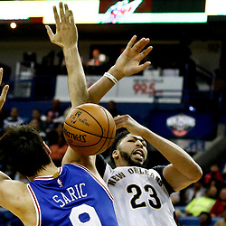 Dec 8, 2016; New Orleans, LA, USA;  New Orleans Pelicans forward Anthony Davis (23) has the ball knocked away by Philadelphia 76ers forward Dario Saric (9) during the second half of a game at the Smoothie King Center.  The 76ers defeated the Pelicans 99-88. Mandatory Credit: Derick E. Hingle-USA TODAY Sports
