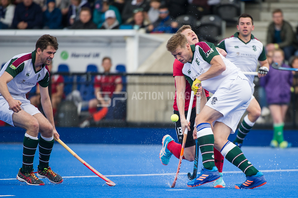 Holcombe's Sam Ward runs into Brendan Creed of Surbiton. Holcombe v Surbiton - Semi-Final - Men's Hockey League Finals, Lee Valley Hockey & Tennis Centre, London, UK on 22 April 2017. Photo: Simon Parker