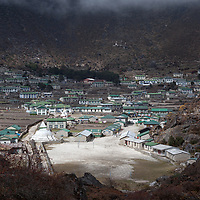 View over Khumjung with the Hillary School and its schoolyard. The Hillary School was founded by Sir Hillary in 1961 and it is the only one high school in the Khumbu region.