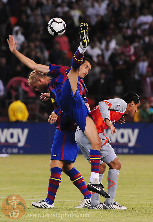 August 8, 2009; San Francisco, CA, USA; FC Barcelona midfielder Sergi Busquets (center) heads the ball during the second half against Chivas de Guadalajara in the Night of Champions international friendly contest at Candlestick Park. The game ended in a 1-1 tie.