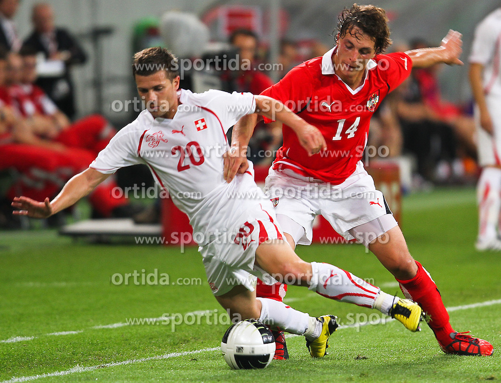 11.08.2010, Wörthersee Stadion, Klagenfurt, AUT, Testspiel, Oesterreich (AUT) vs Schweiz (SUI), im Bild Valentin Stocker ( SUI, #20 ), Julian Baumgartlinger, AUT, EXPA Pictures © 2010, PhotoCredit: EXPA/ D. Scharinger / SPORTIDA PHOTO AGENCY