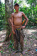 During the Assembly of the 20 years aniversary of their Land demarcation -  the Yanomami - in order to avoid the hassle of women by the guests from other village, created a militia of young warriors. Armed with simbolic weapons linke wooden machine guns and swords, they vigiate the privacy of women´s bath, among other tasks.