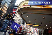 The signs with Oprah Winfrey Presents the Color Purple goes up at the Broadway Theater in Manhattan, NY. 10/3/2005 Photo by Jennifer S. Altman