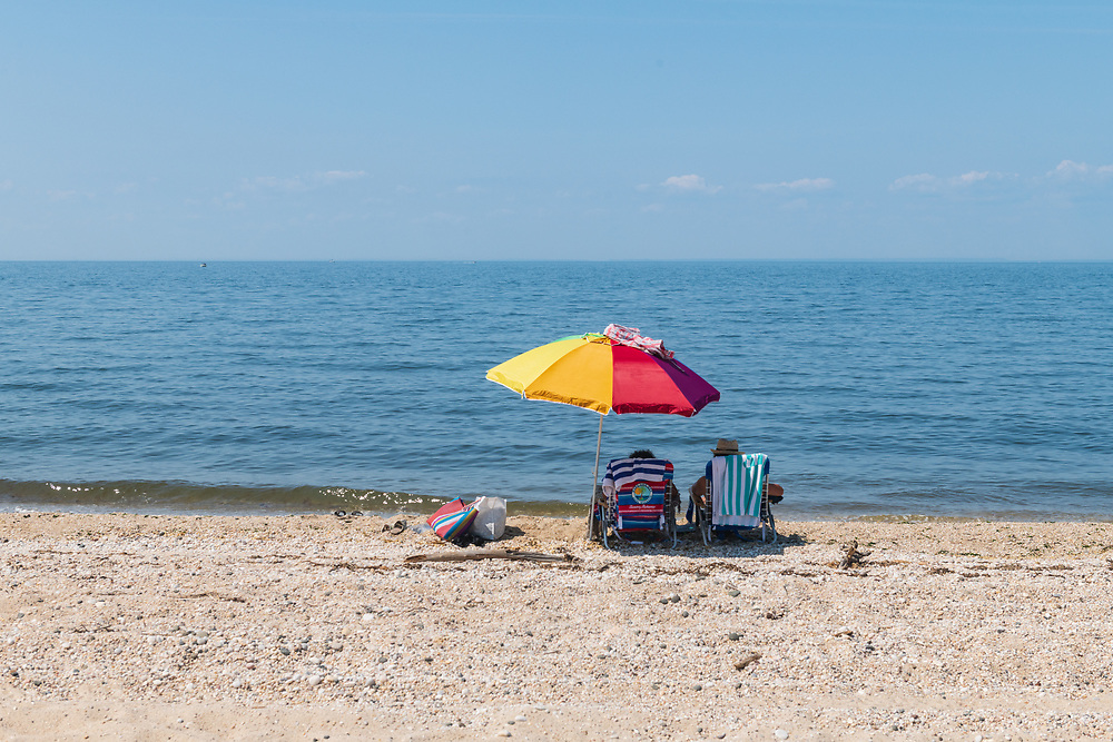"Couple Sitting on Beach on Long Island Sound, Hallock State Park Preserve , Riverhead, NY, A""  225-acre state park and nature preserve located in the towns of Riverhead and Southold in Suffolk County, New York"""