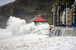© London News Pictures. 21/10/2017. Aberystwyth,UK. Storm Brian, the second named storm of the season, with winds gusting up to 70mph, combined with a high Spring tide, bring huge waves crashing into the seafront in Aberystwyth on the Cardigan Bay coast of west wales. Photo credit: Keith Morris/LNP