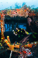 Diver explores the inside of the Lesleen M freighter wreck, sunk as an artificial reef in 1985 in Anse Cochon Bay, St. Lucia.