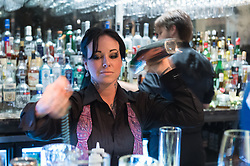 Leslie Ross behind the bar at Sanctuari. (Editorial: Houston Press)