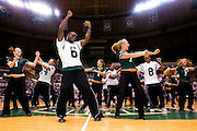 Joshua Abrams, center, dances with Laura Sobeck of the Ohio dance Team, right, and team mates during the Yell Like Hell pep rally in the Convocation Center on Friday, October 12, 2007. .Photo by Kevin Riddell